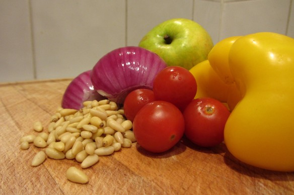 Apple cherry tomatoes pine nuts red onion yellow peper
